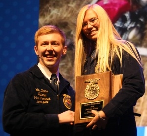 Lindsey Rutherford shares a big smile after being awarded the first place plaque for the Veterinary Science Proficiency Award.