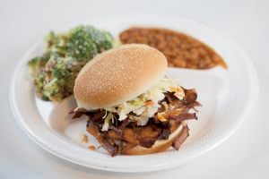 The pulled beef sandwich is served with broccoli salad and baked beans at Corner Pit BBQ in Dellrose, Tennessee.